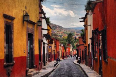 This is how streets look like. They are very small, covered by stone pavement and every wall has a different color.